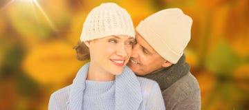 Samengesteld beeld van toevallig paar in warme kleding Stock Foto's