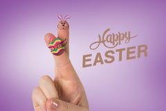Samengesteld beeld van vingers als Pasen-konijntje Stock Afbeeldingen