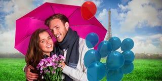 Samengesteld beeld van vrolijk jong paar met bloemen en paraplu royalty-vrije stock foto's