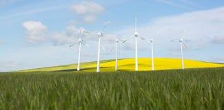 Samengesteld beeld van windmolens zij aan zij tegen witte 3d achtergrond Stock Afbeeldingen