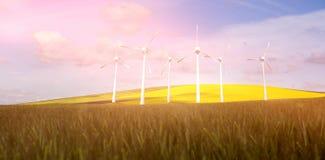 Samengesteld beeld van windmolens zij aan zij tegen witte 3d achtergrond Royalty-vrije Stock Afbeelding