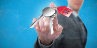 Samengesteld beeld van zakenman die het futuristische digitale 3D scherm met behulp van Stock Fotografie