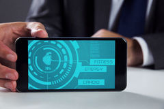 Samengesteld beeld van zakenman die smartphone gebruiken Stock Foto