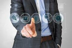 Samengesteld beeld van zakenman in grijs kostuum die op menu richten Royalty-vrije Stock Fotografie