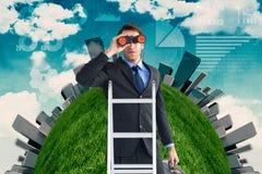 Samengesteld beeld van zakenman het kijken op een ladder royalty-vrije stock foto's