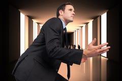 Samengesteld beeld van zakenman het stellen met uit wapens Stock Foto's