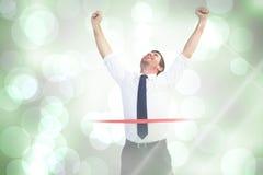 Samengesteld beeld van zakenman het vieren succes met omhoog wapens Royalty-vrije Stock Afbeeldingen