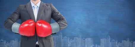 Samengesteld beeld van zakenman met bokshandschoenen Stock Afbeelding