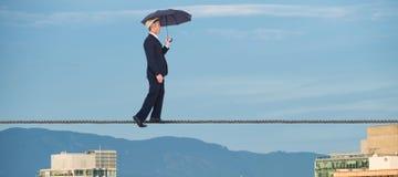Samengesteld beeld van zakenman met paraplu die op witte achtergrond lopen Royalty-vrije Stock Afbeeldingen