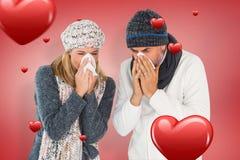 Samengesteld beeld van ziek paar in de wintermanier het niezen Royalty-vrije Stock Foto's