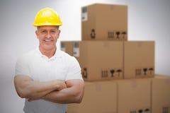 Samengesteld 3d beeld van arbeider die bouwvakker in pakhuis dragen Stock Afbeeldingen
