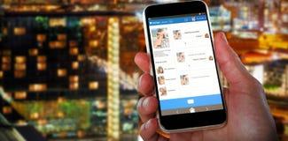 Samengesteld 3d beeld van close-up van mobiel handholding Stock Foto