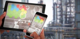 Samengesteld 3d beeld van dichte omhooggaand van handen die digitale tablet en mobiele telefoon met behulp van Royalty-vrije Stock Afbeeldingen