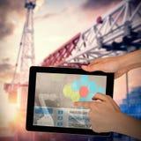 Samengesteld 3d beeld van handen wat betreft digitale tablet tegen witte achtergrond Stock Foto