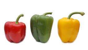 Samenstelling met drie peper op witte achtergrond Stock Fotografie