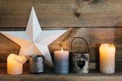 Samenstelling met kaarsen, sterren Stock Afbeeldingen