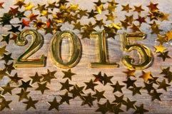 Samenstelling van gouden nummer 2015 jaar en gouden asteri Stock Afbeelding