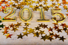 Samenstelling van gouden nummer 2015 jaar en gouden asteri Royalty-vrije Stock Afbeelding