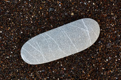 Samenvatting met de droge ronde reeble achtergrond van het stenen donkere bruine zand Stock Afbeelding