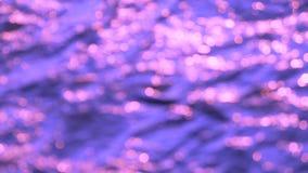 Samenvatting vaag bokeh roze op purpere achtergrond stock video
