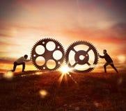 Samenwerking bij het werkconcept met toestellenmechanisme stock fotografie