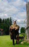 Sami shaman and his assistant - dog Royalty Free Stock Photography