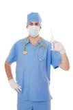 Samiec doktorski mienie strzykawka w jego ręce. Obraz Stock