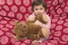 Samira Bear 2. Little girl in her pyjamas cuddling her teddybear stock photos