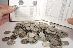 samla för mynt arkivfoton