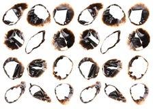 Samling av brända hål i ett stycke av papper som isoleras på vit Fotografering för Bildbyråer