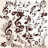 Samling av dekorativa musikbeståndsdelar för vektor med virvlar och t Royaltyfri Bild