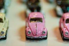 Samling av den färgrika lilla gulliga bilen Slut upp gullig mycket liten modell Royaltyfri Foto