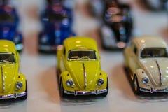 Samling av den färgrika lilla gulliga bilen Slut upp gullig mycket liten modell Arkivbilder