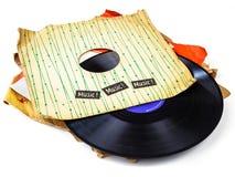 Samling av den gammala vinylen lp med muffar som isoleras på vit Arkivfoton