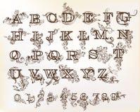 Samling av engelskt abc för vektor i tappningstil med virvlar Royaltyfri Foto