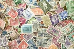 Samling av gamla förföll internationalstämplar Arkivbild
