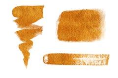 Samling av guld- målade designbeståndsdelar som isoleras på vit bakgrund Arkivfoton