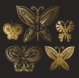 Samling av guld- fjärilar Arkivbilder