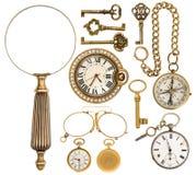 Samling av guld- tappningtillbehör, smycken och objekt royaltyfri bild