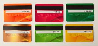 Samling av isolerade färgglade kreditkortar Arkivbilder