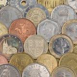 Samling av mynt som bildar en bakgrund royaltyfria foton
