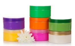 Samling av olika skönhethygienbehållare royaltyfri foto