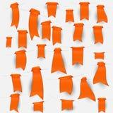 Samling av orange bokmärker Arkivfoto
