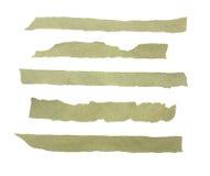 Samling av rev sönder stycken av papper som isoleras på vit Royaltyfri Foto
