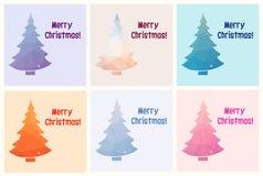 Samling av sex glade julkort med polygonjulgranen Arkivfoto
