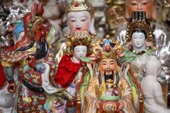 Samling av små kinesiska statyer Arkivbilder
