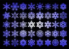 Samling av snöflingor i vektor stock illustrationer