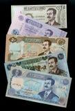 Samling av ståenden Saddam Hussein för irakiska dinar för sedlar Royaltyfri Foto