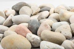 Samling av stenar på vit Royaltyfri Fotografi