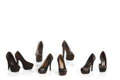 Samling av svarta skor för hög häl Royaltyfri Bild